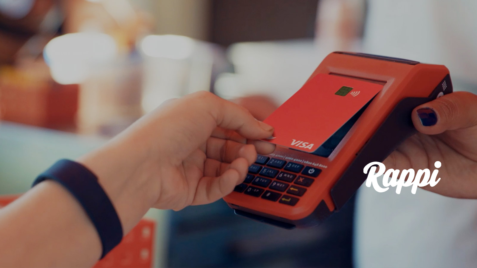 Person using Rappi card at point-of-sale.