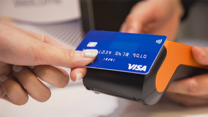 tapping credit card on payment device